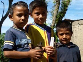 Children with kerosene lamps
