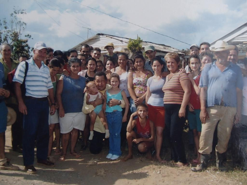 Hugo Chavez (centre left) meets people in San Andres after Hurricane Gustav