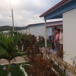 Residents whose homes were destroyed in hurricanes in their new 'petrocasas' homes.