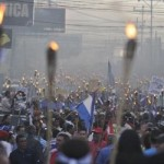 March of the torch-bearers, Tegucigalpa, Honduras. Photo: AP/Fernando Antonio.
