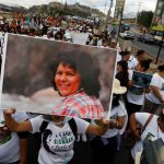 A protester holds up a picture of Berta Cáceres during a march in Tegucigalpa, Honduras, on March 1, 2017, the first anniversary of her murder. (Reuters / Jorge Cabrera)