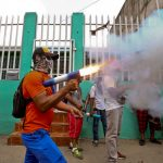 A masked protester shoots off his homemade mortar in the Monimbó neighborhood during clashes with police, in Masaya, Nicaragua, June 2, 2018. (AP Photo / Esteban Felix)